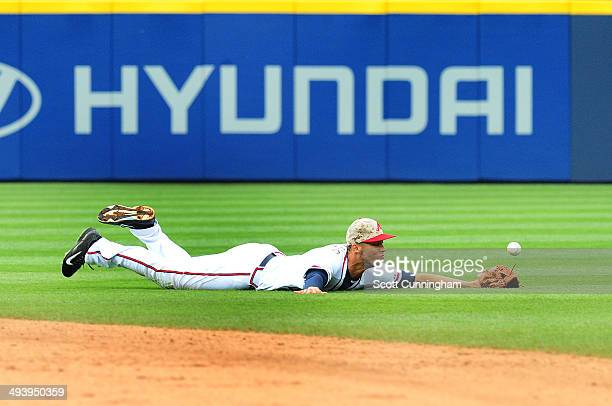 Andrelton Simmons of the Atlanta Braves is unable to reach a 7th inning run scoring single by AJ Pierzynski of the Boston Red Sox at Turner Field on...