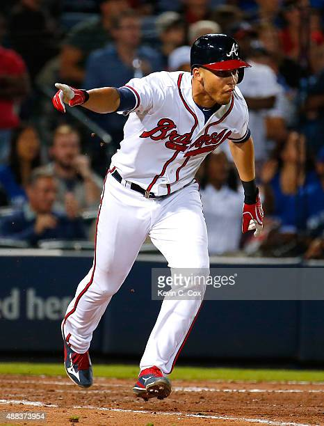 Andrelton Simmons of the Atlanta Braves reacts after hitting a walkoff RBI single in the ninth inning against the Toronto Blue Jays at Turner Field...