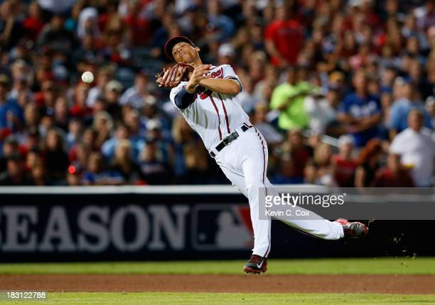 Andrelton Simmons of the Atlanta Braves throws to first in the seventh inning against the Los Angeles Dodgers during Game Two of the National League...