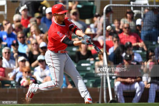 Andrelton Simmons of the Los Angeles Angels hits a sacrifice fall ball in the fifth inning of the spring training game against the Arizona...