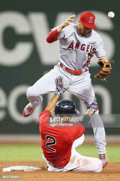 Andrelton Simmons of the Los Angeles Angels of Anaheim bobbles the ball as Xander Bogaerts of the Boston Red Sox slides into second base in the sixth...