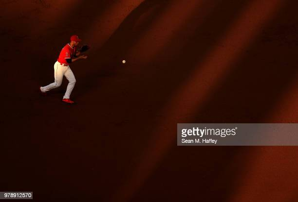 Andrelton Simmons of the Los Angeles Angels of Anaheim fields a grounder hit by David Peralta of the Arizona Diamondbacks during the inning of a game...