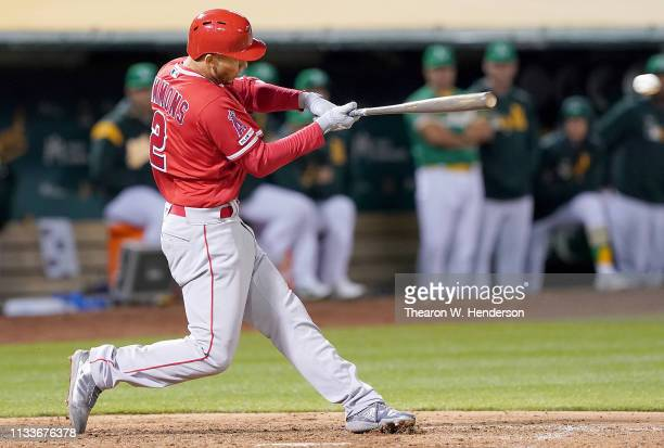 Andrelton Simmons of the Los Angeles Angels of Anaheim hits a bases loaded tworun rbi single against the Oakland Athletics in the top of the eighth...