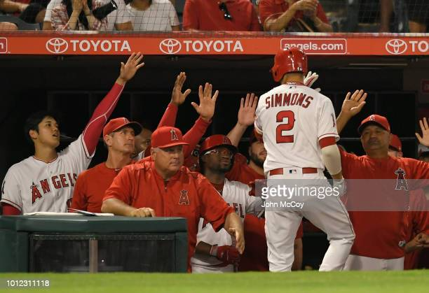 Andrelton Simmons of the Los Angeles Angels of Anaheim is congratulated on his fourth inning home run against the Detroit Tigers at Angel Stadium on...