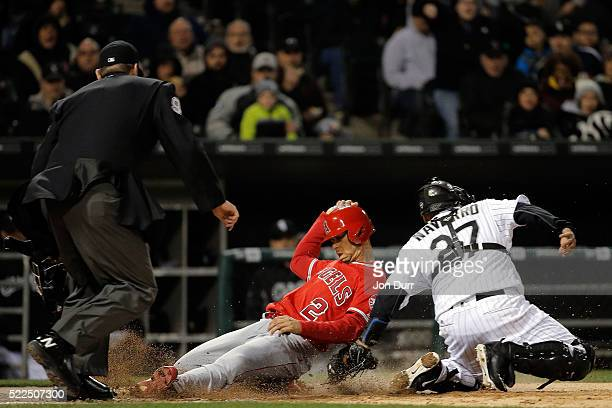Andrelton Simmons of the Los Angeles Angels of Anaheim is tagged out by Dioner Navarro of the Chicago White Sox at home plate during the seventh...