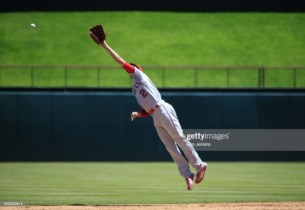 Andrelton Simmons #2 of the Los Angeles Angels of Anaheim leaps for a run scoring single by Carlos Gomez #14 of the Texas Rangers in the first inning at Globe Life Park in Arlington on April 30, 2017 in Arlington, Texas.
