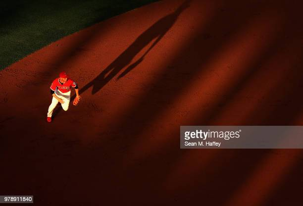 Andrelton Simmons of the Los Angeles Angels of Anaheim runs to field a grounder hit by David Peralta of the Arizona Diamondbacks during the inning of...