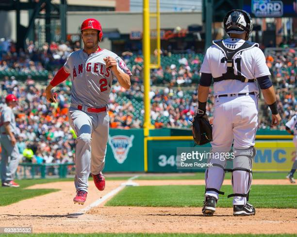 Andrelton Simmons of the Los Angeles Angels of Anaheim scores in the fifth inning to take a 54 lead during a MLB game against the Detroit Tigers at...