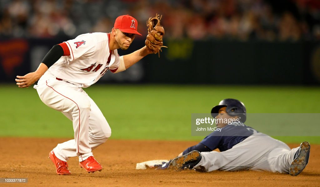 Andrelton Simmons #2 of the Los Angeles Angels of Anaheim tags Jean Segura #2 of the Seattle Mariners out trying to steal second base in the fifth inning at Angel Stadium on September 14, 2018 in Anaheim, California.