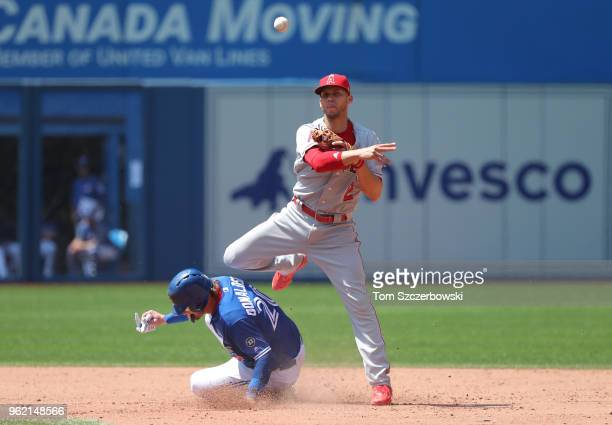 Andrelton Simmons of the Los Angeles Angels of Anaheim turns a double play in the sixth inning during MLB game action as Josh Donaldson of the...