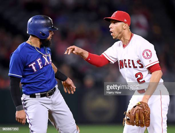 Andrelton Simmons of the Los Angeles Angels reacts to the slide of Rougned Odor of the Texas Rangers despite turning a double play to end the game...