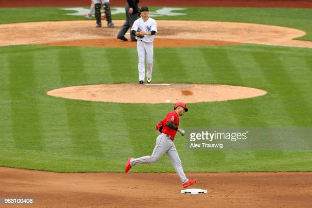 Andrelton Simmons of the Los Angeles Angels rounds the bases after hitting a solo home run in the sixth inning during a game against the New York...