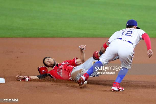 Andrelton Simmons of the Los Angeles Angels steals second base against Rougned Odor of the Texas Rangers in the top of the first inning at Globe Life...