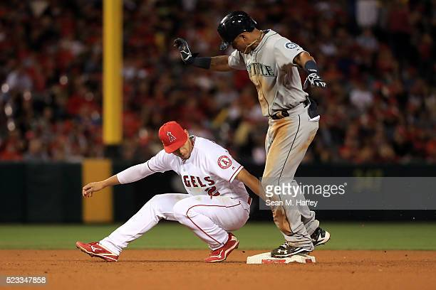 Andrelton Simmons of the the Los Angeles Angels of Anaheim tags Ketel Marte of the the Seattle Mariners who is safe after stealing second base during...