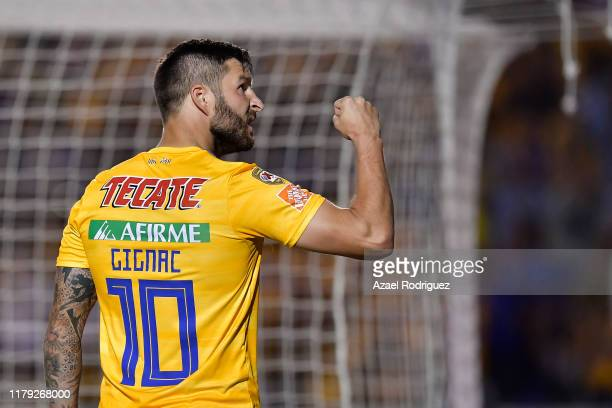 AndrePierre Gignac #10 of Tigres celebrates after scoring his team's third goal via penalty during the 13th round match between Tigres UANL and...