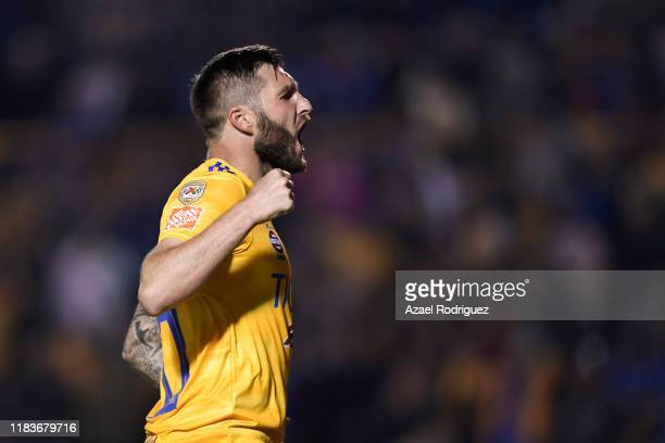 AndrePierre Gignac #10 of Tigres celebrates after scoring his team's first goal during the 15th round match between Tigres UANL and Cruz Azul as part...