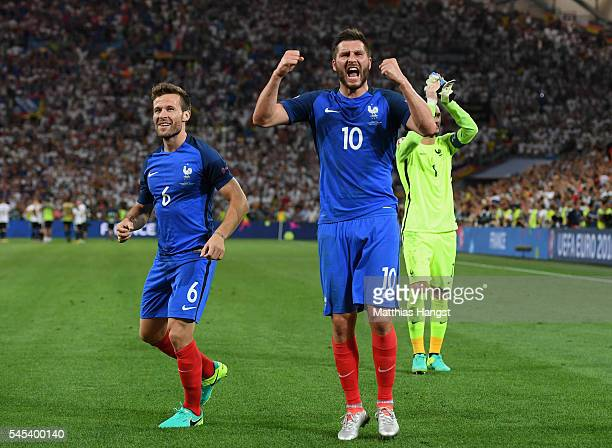 AndrePierre Gignac and Yohan Cabaye of France celebrate after their team's 20 win in the UEFA EURO semi final match between Germany and France at...