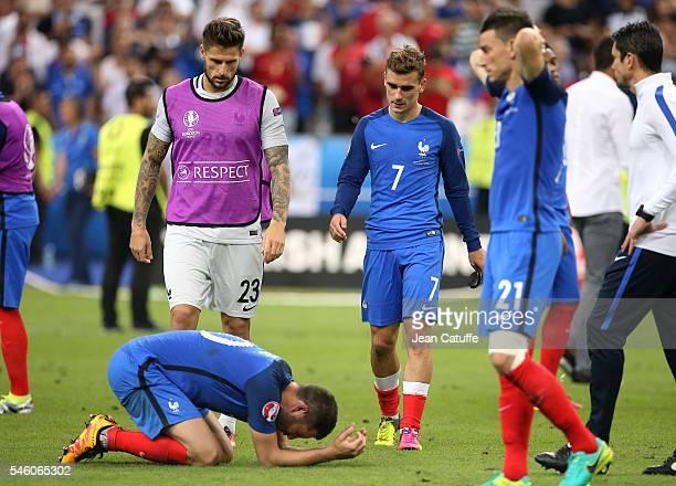 AndrePierre Gignac goalkeeper of France Benoit Costil Antoine Griezmann Laurent Koscielny of France react following the UEFA Euro 2016 final match...