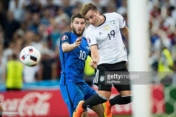 AndrePierre Gignac Mario Gotze Goetze during the UEFA EURO semi final match between Germany and France at Stade Velodrome on July 7 2016 in Marseille...