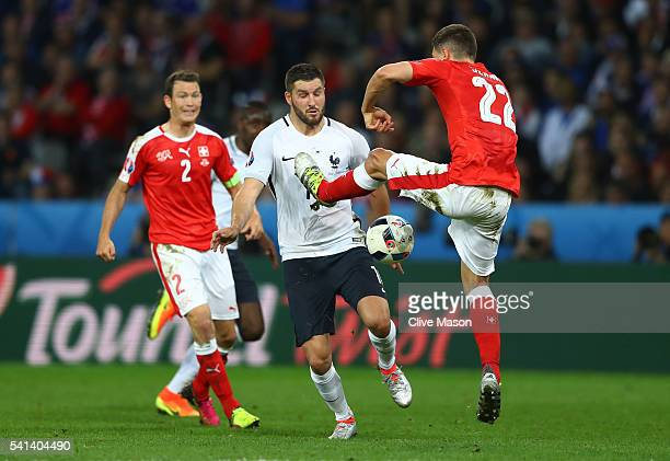 AndrePierre Gignac of France and Fabian Schaer of Switzerland compete for the ball during the UEFA EURO 2016 Group A match between Switzerland and...