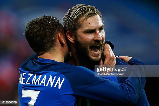 AndrePierre Gignac of France celebrates scoring his teams second goal of the game with Antoine Griezmann during the International Friendly match...