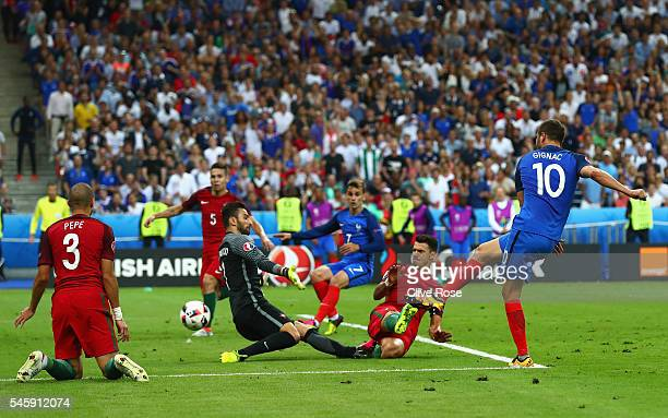 Andre-Pierre Gignac of France has a shot on goal past Rui Patricio of Portugal and Jose Fonte which hits the post during the UEFA EURO 2016 Final...