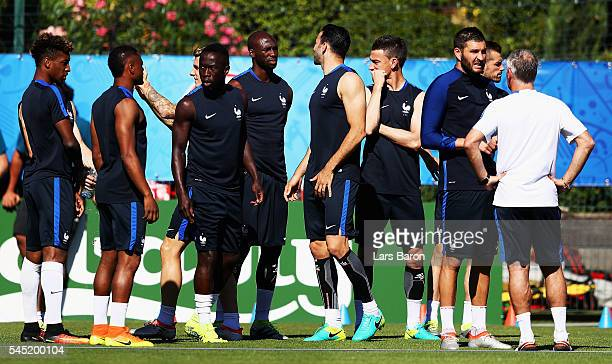 AndrePierre Gignac of France speaks with head coach Didier Deschamps during a France training session ahead of their UEFA Euro 2016 Semi final...