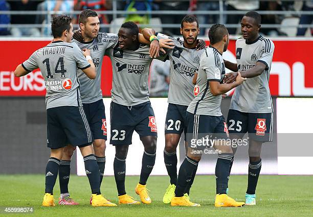 AndrePierre Gignac of OM celebrates his first goal with teammates Florian Thauvin Benjamin Mendy JacquesAlaixys Romao Gilbert Wanga Imbula of OM...