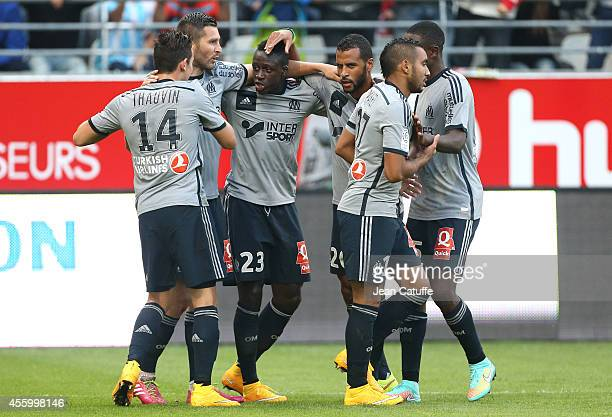 AndrePierre Gignac of OM celebrates his first goal with teammates Florian Thauvin Benjamin Mendy JacquesAlaixys Romao Dimitri Payet during the French...