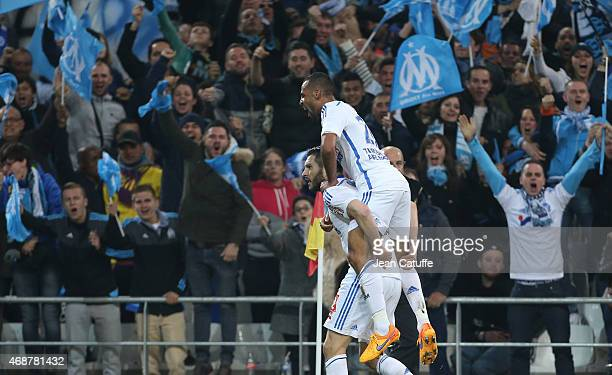 AndrePierre Gignac of OM celebrates his goal with JacquesAlaixys Romao of OM during the French Ligue 1 match between Olympique de Marseille and Paris...