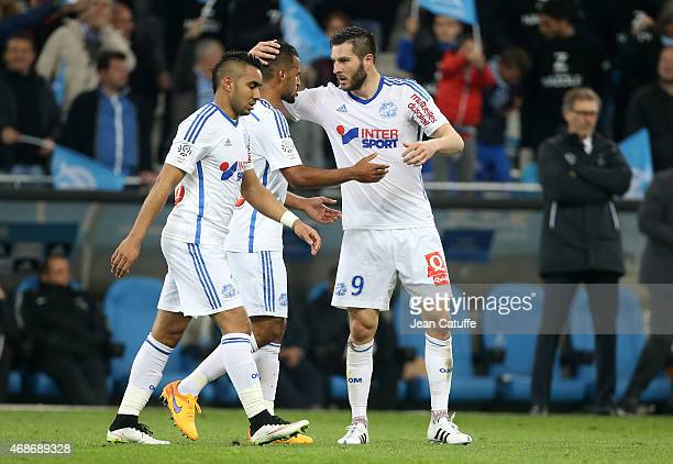AndrePierre Gignac of OM celebrates scoring the second goal for his team with team mates Dimitri Payet and JacquesAlaixys Romao during the French...