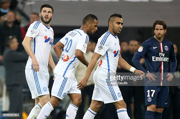 AndrePierre Gignac of OM celebrates scoring the second goal for his team with team mates JacquesAlaixys Romao and Dimitri Payet during the French...