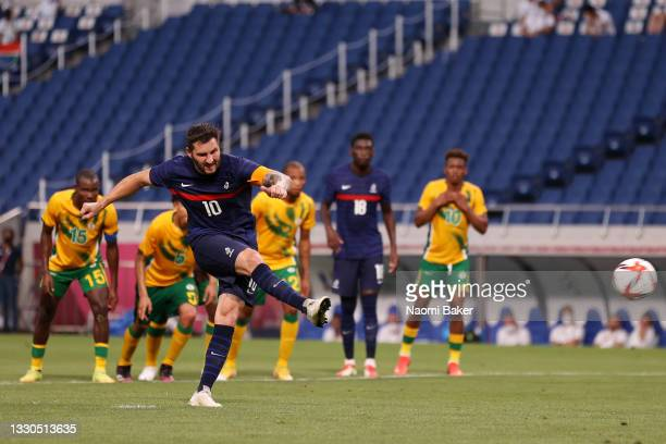 Andre-Pierre Gignac of Team France scores their side's third goal from the penalty spot during the Men's First Round Group A match between France and...