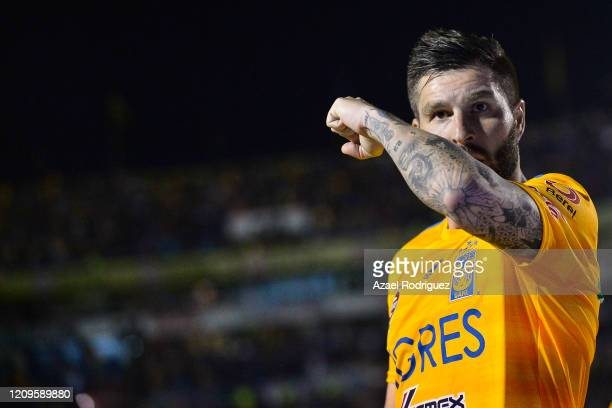AndrePierre Gignac of Tigres celebrates after scoring his team's first goal via penalty during the 8th round match between Tigres UANL and Pumas UNAM...