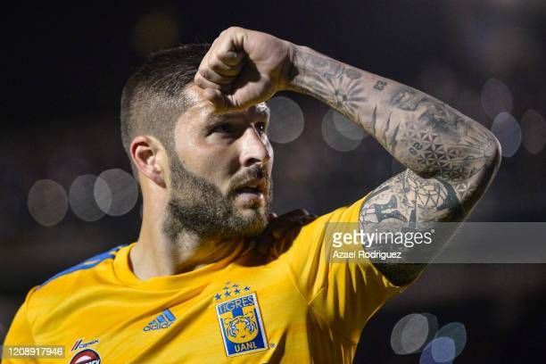 AndrePierre Gignac of Tigres celebrates after scoring his team's third goal via penalty during the round of 16 match between Tigres UANL and Alianza...