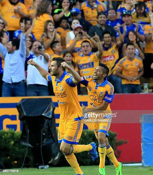 AndrePierre Gignac of Tigres celebrates his goal against Queretaro during their Mexican Apertura 2015 tournament football match at the Universitario...