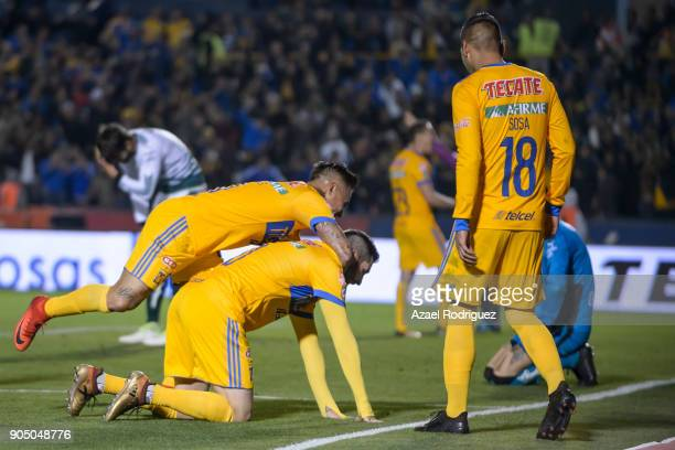AndrePierre Gignac of Tigres celebrates with teammate Eduardo Vargas after scoring his team's second goalduring the 2nd round match between Tigres...