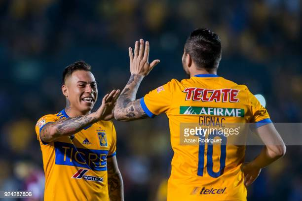 AndrePierre Gignac of Tigres celebrates with teammate Eduardo Vargas after scoring his team's first goal during the 9th round match between Tigres...