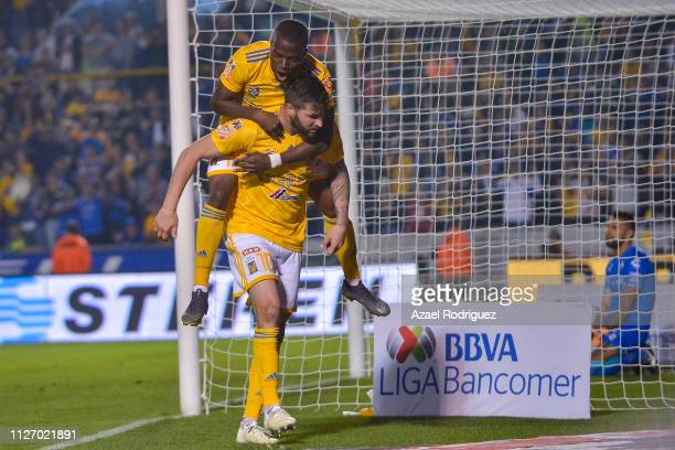 Andre-Pierre Gignac of Tigres celebrates with teammate Enner Valencia after scoring his team's second goal during the fifth round match between...