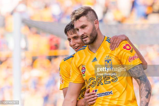 Andre-Pierre Gignac of Tigres celebrates with teammate Jurgen Damm after scoring his team's first goal during the second round match between Tigres...