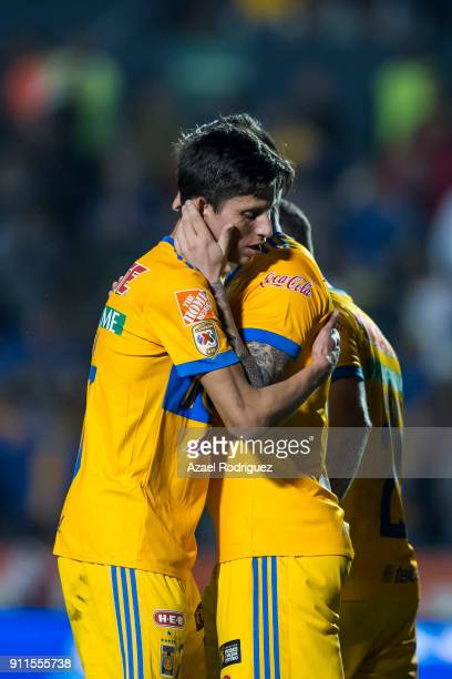 Andre-Pierre Gignac of Tigres celebrates with teammate Jurgen Damm after scoring his team's third goal during the 4th round match between Tigres UANL...