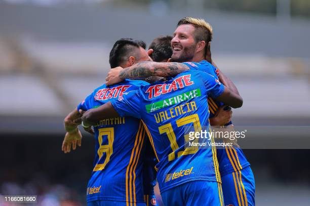 AndrePierre Gignac of Tigres celebrates with teammates after scoring the first goal of his team during the 3rd round match between Pumas UNAM and...
