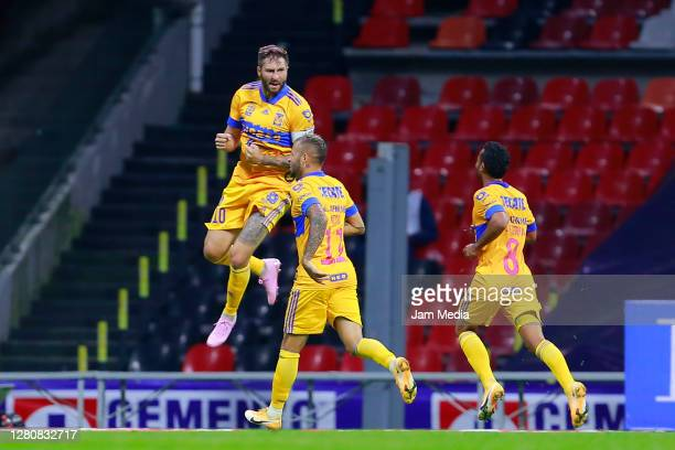 AndrePierre Gignac of Tigres celebrates with teammates after scoring the second goal of his team during the 14th round match between Cruz Azul and...