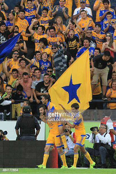 AndrePierre Gignac of Tigres celebrates with teammates after scoring against Chiapas during their Mexican Apertura 2015 tournament football match at...