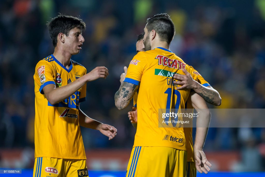Andre-Pierre Gignac of Tigres celebrates with teammates after scoring his team's third goal during the 4th round match between Tigres UANL and Pachuca as part of the Torneo Clausura 2018 Liga MX on January 27, 2018 in Monterrey, Mexico.