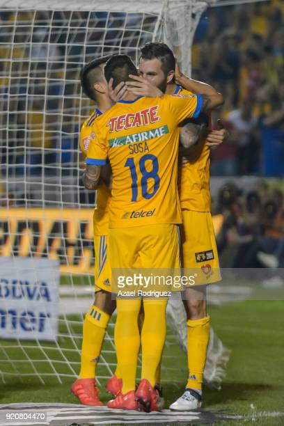 AndrePierre Gignac of Tigres celebrates with teammates after scoring his team's second goal during the 8th round match between Tigres UANL and Atlas...