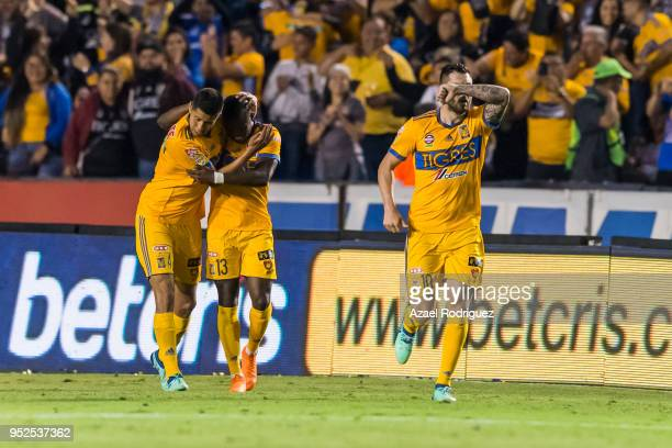 AndrePierre Gignac of Tigres celebrates with teammates after scoring his teams second goal during the 17th round match between Tigres UANL and...