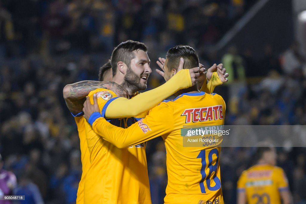 Andre-Pierre Gignac of Tigres celebrates with teammates Eduardo Vargas and Ismael Sosa after scoring his team'u2019s second goalduring the 2nd round match between Tigres UANL and Santos Laguna as part of the Torneo Clausura 2018 Liga MX on January 13, 2018 in Monterrey, Mexico.