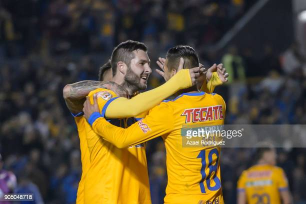 AndrePierre Gignac of Tigres celebrates with teammates Eduardo Vargas and Ismael Sosa after scoring his team'u2019s second goalduring the 2nd round...