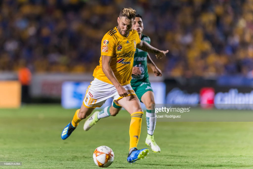 cef91fe4449 Andre-Pierre Gignac of Tigres drives the ball during the 1st round ...